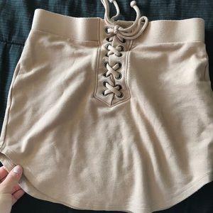 Nude color mini skirt